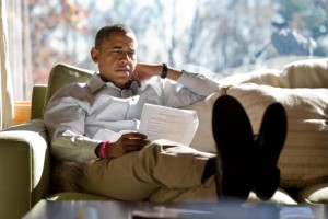 CAMP DAVID, MD - OCTOBER 21: In this handout image provided by The White House, U.S. President Barack Obama reads briefing material while meeting with advisors inside his cabin October 21, 2012 at Camp David, Maryland. The president also convened a conference call with Homeland Security Advisor John Brennan, FBI Director Robert Mueller and Chief of Staff Jack Lew to discuss the mass shooting in Wisconsin as the news unfolded. (Photo by Pete Souza/The White House via Getty Images)